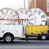 A crew with D & M Masonry load clock faces into a truck after lowering them from the tower on top of the Second Baptist Church along Main Street in downtown New Albany on Friday afternoon. The company removed the clock faces and other decorative elements from the tower to be restored in a shop off site. Staff photo by Christopher Fryer