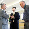 Andrew Takami, the new director of the Purdue University College of Technology at New Albany, center, speaks with Bill White, the executive director of the Corporate College at Ivy Tech Community College, and John Hartstern, a former director of development at Indiana University Southeast, during a reception for Takami in the main lobby of the school in New Albany on Tuesday afternoon. Takami started the position in early April, replacing Andrew Schaffer, who moved up to be the associate dean for Purdue University's eight college of technology locations in Indiana. Staff photo by Christopher Fryer