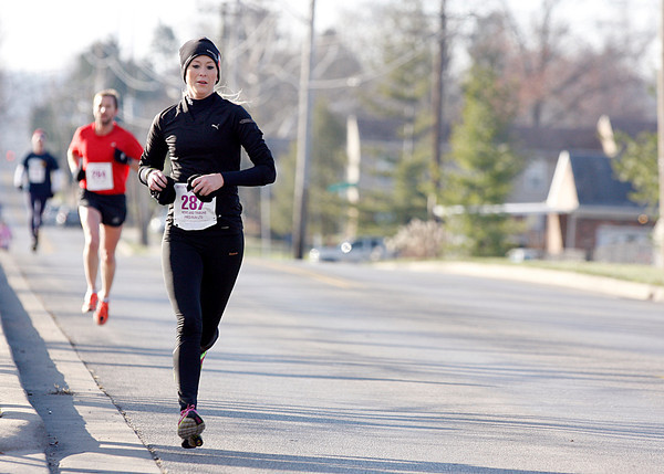 Erika Wilson, 22, Palmyra, was the first woman to finish Fast Freddie's Festive Five-Mile Foot Feast on Thursday. About 930 runners actually made the event with another 80 who ran the two-mile run. Staff photo by Jerod Clapp