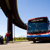 A new Transit Authority of River City commuter coach pulls out of a parking lot next to the Big Four Bridge in Louisville following a press conference on Monday afternoon. Ten of the new commuter coaches will be put into service today, and 11 more will join the fleet by November. They run using clean diesel engines and are equipped with on-board Wi-Fi and power outlets for personal electronic devices. Staff photo by Christopher Fryer