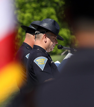 Indiana State Police Capt. Steven R. Priest reads the names the 46 Indiana State Police personnel that have died in the line of duty. Staff photo by C.E. Branham