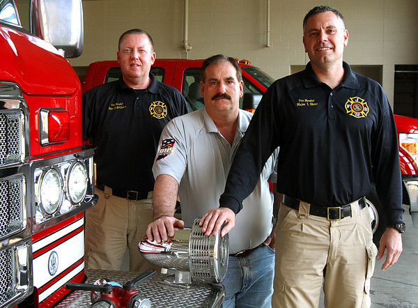Jeffersonville firefighters Mark McCutcheon, Rick VanGilder and Travis Sharp recently spent two weeks in the City of Long Beach in New York aiding in Hurricane Sandy relief. Staff photo by C.E. Branham