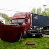A semitrailer and a passenger vehicle sit at the intersection of Greenville Georgetown Road and Ind. 64 after being involved in an injury accident in Georgetown on Wednesday afternoon. The accident occurred at about 3:45 p.m. and the 17-year-old male driving the passenger vehicle was transported to University of Louisville Hospital after being extricated from the vehicle. Staff photo by Christopher Fryer