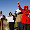 From left, Raymond Cousins, of New Albany, Marcia Booker, of New Albany, Kenneth Long, of New Albany, and Mattie Jones, of Louisville, react to a motorist's response to their protest in front of the New Albany-Floyd County Consolidated School Corporation Administration Services Center along Grant Line Road in New Albany on Wednesday morning. The protestors do not believe that administration officials properly handled an incident involving student costumes at a Highland Hills Middle School basketball game against Parkview last month that were perceived by some to be racist. Staff photo by Christopher Fryer