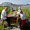 From left, Michael Weston II, of Jeffersonville, Darrell Corbitt, of Goshen, Ky., Paul Olliges, of Louisville, and Mike Kolo, of Edwardsburg, Mich., work together while moving a discarded refrigerator up the river bank at the Falls of the Ohio State Park during the annual Clark County Ohio River Sweep on Saturday morning. Staff photo by Christopher Fryer