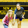 Teen Work Experience program volunteer Katie Butler, 14, right, holds hands with Cheyenne McCutcheon, 5, as they play the red light/green light game in the gymnasium at the Griffin Recreation Center in New Albany on Thursday morning. The program was started this year by the New Albany Parks Department to help teenagers learn job skills. Staff photo by Christopher Fryer