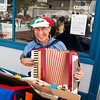 Accordionist Michael Kovatch, New Albany, plays traditional Italian music at the corner of Pearl Street and Court Avenue during the fourth annual Jeffersonville Italian Festival on Saturday afternoon. Staff photo by Christopher Fryer