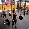 Competitors do dead lifts during a CrossFit competition at Clark Floyd CrossFit in New Albany on Saturday morning. Rachel Kellington placed first in the women's competition and Charlie Sims, of Louisville, placed first in the men's. The owner of the facility, Case Belcher, graduated from Henryville High School in 2005 and held the event to raise tornado relief funds for the school's athletic department. Staff photo by Christopher Fryer