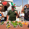 From left, Oreya Ou, Louisville, Phil Crea, Jeffersonville, and Greg Edwards, Louisville, participate in the hot pepper eating contest during the fourth annual Jeffersonville Italian Festival on Saturday afternoon. All three finalists completed the challenge. Staff photo by Christopher Fryer