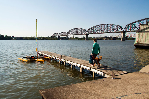 Mary Southerland, 35, Salt Lake City, walks to her sea kayak with her service dog Henry on Friday morning before leaving from the Jeffersonville riverfront to head down the Ohio River on the next leg of her 981-mile journey from Pittsburgh to Cairo, Ill. Southerland suffers from post traumatic stress disorder and is kayaking the entire length of the Ohio River to raise awareness for the disorder. Staff photo by Christopher Fryer