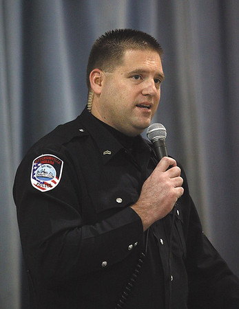 Jeffersonville Police Department D.A.R.E officer Jason Jackson conducted the graduation ceremony Friday morning at Thomas Jefferson Elementary.  Staff photo by C.E. Branham