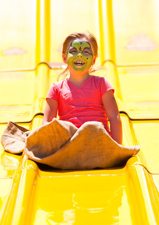Autumn Lynn, 6, Clarksville, smiles as she makes her way down the #1 Slide ride during Sellersburg Celebrates at Silver Creek Community Park on Saturday afternoon. Staff photo by Christopher Fryer