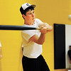 Clarksville High School junior third baseman Zach Mikel swings at a pitch during their wiffle ball game on Friday afternoon in the gym at Clarksville Junior High School. The players split up into three teams of six and played 50 innings to raise money for their program, and they are donating half of the proceeds to aide the Decker family that was affected by the March 2 tornadoes. Staff photo by Christopher Fryer