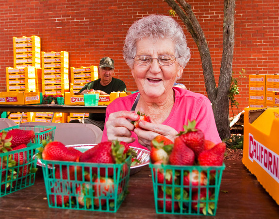 Esther Book, of Starlight, stems strawberries so they can be washed and prepared for the strawberry shortcake booth at the 34th annual Starlight Strawberry Festival at St. John's Church on Saturday afternoon. Staff photo by Christopher Fryer