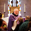 Father Joseph West marks the foreheads of congregation members during Ash Wednesday mass at St. Anthony Padua Catholic Church in Clarksville. Ash Wednesday marks the beginning of Lent, a period of penitence and fasting that lasts for 40 weekdays until Easter. Staff photo by Christopher Fryer