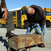 Brian Wimsatt saws open a time capsule buried in 1979 at the Jeffersonville Alternative School. The school is now Corden Porter. The time capsule was opened Wednesday. Staff photo by C.E. Branham