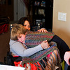 Trish Gilles comforts her son Caleb, who wrapped himself in their prayer shawl, after he saw a warning about severe weather at Trish's mother's home in Sellersburg. The family is still staying in Sellersburg while their Henryville home is being rebuilt after it was destroyed during the March 2 tornadoes. Staff photo by Christopher Fryer