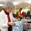 Vonda Morgan and several other volunteers wrapped gifts for the Home Instead Senior Care Be a Santa to a Senior program Monday at Autumn Woods Health care in New Albany. Staff photo by C.E. Branham