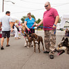 Jason and Lydia Mattingly, center, Harrison County, hold their boxers, Jayda, left, and Mason, while they attend the ninth annual Purina Rally to Rescue in downtown New Albany on Saturday morning. Staff photo by Christopher Fryer