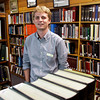 Matt Eiden, of Louisville, stands in the Stuart Barth Wrege Indiana History Room where he works as an archivist for the New Albany-Floyd County Public Library in New Albany. Eiden was hired last month and is the first person to hold the position. Staff photo by Christopher Fryer