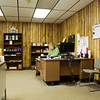 Floyd County Solid Waste Management District operations manager Mary Lou Byerley works from her desk in the North Annex on Grant Line Road in New Albany on Thursday afternoon. The Solid Waste office is the last tenant in the building, but will be relocating to the new Pine View Government Center. The future of the historic building will be discussed by the Floyd County Commissioners next month. Staff photo by Christopher Fryer