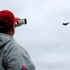 Dave Wurm, of Charlestown, photographs an aircraft with his cell phone during the Thunder Over Louisville air show on Saturday evening. Staff photo by Christopher Fryer