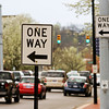 One-way traffic signs sit at the intersection of Spring and Pearl streets as traffic moves West on Friday afternoon in New Albany. Staff photo by Christopher Fryer