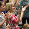 Students in Mrs. Merrifield's class at Pleasant Ridge Elementary give her a standing ovation at the end of the ceremony naming Merrifield the WHAS 11 ExCEL Award winner and Greater Clark Teacher of the Year. Staff photo by C.E. Branham