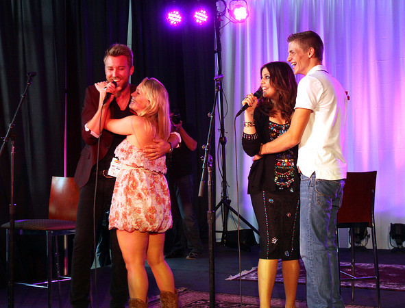 Lady Antebellum members Charles Kelley and Hillary Scott dance with Henryville students Erin Hairston, left, and Jade Jones at the KFC YUM! Center on Wednesday evening. The band played a small set for the students before playing their Rebuild Henryville benefit concert. Staff photo by C.E. Branham