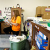 New Directions assistant coordinator Katy Hartman, of Louisivlle, unpacks and organizes supplies in the new Open Door Youth Services offices at the Pine View Government Center along Corydon Pike in New Albany on Tuesday afternoon. Staff photo by Christopher Fryer