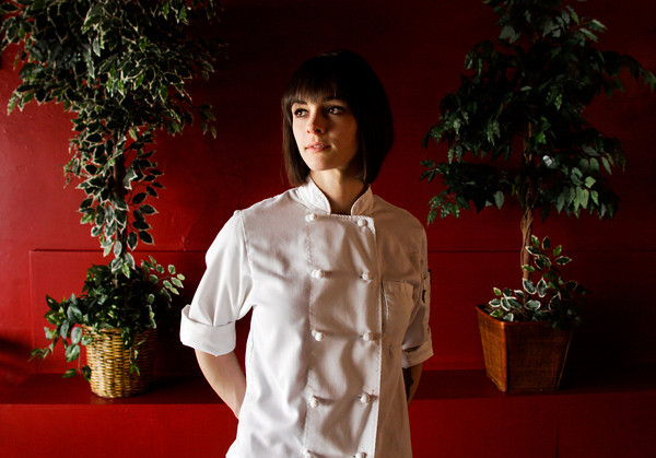 "Pastry chef Ashley Holt, of Jeffersonville, stands in downtown Jeffersonville on Wednesday afternoon. Holt won The Learning Channel's reality television show ""Next Great Baker"" on Monday night. A former model, Holt has been baking for six years and currently works at the Louisville Country Club. She plans to open her own shop in Louisville. Staff photo by Christopher Fryer"