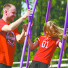 Christopher Kokoski and his daughter Lilly Kokoski enjoy the new playground equipment at Vissing Park in Jeffersonville on Saturday. The pair were attending a grand opening and ribbon cutting ceremony at the redesigned park. Staff photo by C.E. Branham