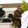 "Jep Bright, Louisville, son of the late sculptor Barney Bright, uncovers the sculpture ""Landscape"" during an unveiling ceremony in New Albany's Bicentennial Park at the corner of Pearl and Spring streets on Thursday afternoon. The sculpture, from 1958, was his father's first commissioned public piece. Staff photo by Christopher Fryer"
