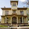 The Pepin Mansion sits on its location along East Main Street in New Albany on Thursday afternoon. Owner Ron Smith held an official grand opening for the restored home on Thursday, which he is operating as a retreat center, rehearsal hall and bed and breakfast. Staff photo by Christopher Fryer