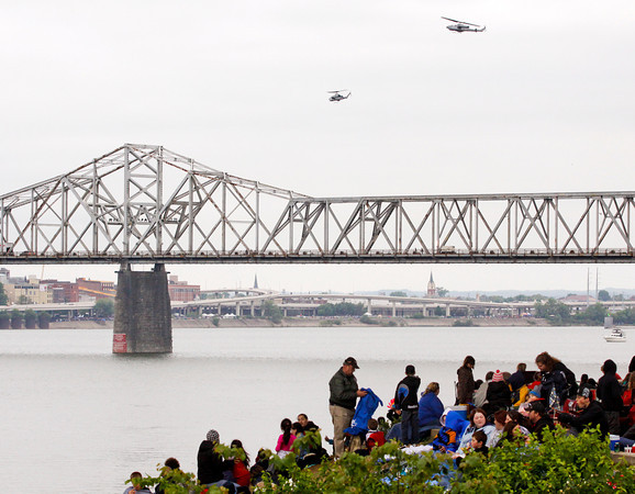 Two helicopters fly over the Ohio River while spectators gather underneath Interstate 65 in Jeffersonville during Thunder Over Louisville on Saturday evening. Staff photo by Christopher Fryer
