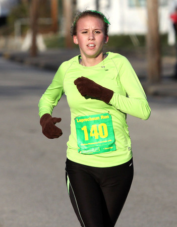 Silver Creek High School student Maggie Shields was the first female to finish the Leprechaun Run Tuesday night. Staff photo by C.E. Branham