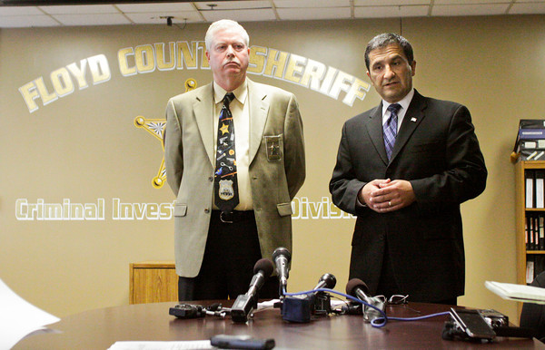 Floyd County Prosecutor Keith Henderson, right, and Floyd County Sheriff Darrell Mills speak during a press conference on Wednesday afternoon concerning Lisa Shuler and the murder that allegedly took place in the home where she was living along Wabash Avenue in Floyd County on Monday night. According to the Floyd County Sheriff's Department, Shuler shot Charles Pierce, of Louisville, with a hand gun inside the home. Staff photo by Christopher Fryer
