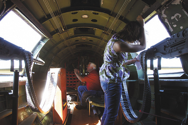 "A passenger on the B-17 bomber ""Memphis Belle"" looks out the waist gunner hatches on a flight over southern Indiana Monday afternoon. Staff photo by C.E. Branham"