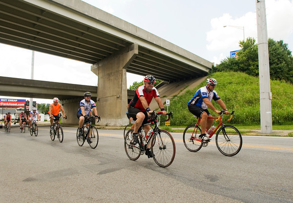 Cyclists with Cops Cycling for Survivors travel along West Main Street as they pass through New Albany on Wednesday afternoon. The group left Indianapolis on July 8 to ride around the perimeter of Indiana to honor officers killed in the line of duty and to raise awareness and funds for the families of those officers. The ride will end after 13 days at Crown Hill Cemetery in Indianapolis. Staff photo by Christopher Fryer