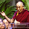 The Dalai Lama's image is projected on an overhead screen while he speaks during a public talk that focused on compassion and its importance in today's world at the KFC Yum! Center in Louisville on Sunday afternoon. Staff photo by Christopher