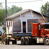 The former Emery's Ice Cream Shop building was moved Monday morning from a storage location to its permanent location on the corner of Eighth Street and Culbertson Avenue in New Albany. The building will be used as a sustainable living techniques classroom and kitchen in the planned Urban Fusion Community Garden. The building was moved by Indiana Landmarks. Staff photo by C.E. Branham
