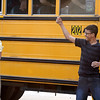 Henryville High School principal Troy Albert watches as students unload from a bus to attend classes at Mid-America Science Park in Scottsburg, Ind., on Monday, April 2. Staff photo by C.E. Branham