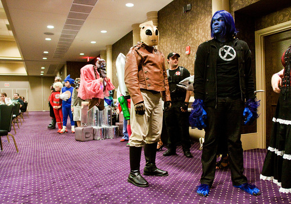 Bob Starks, dressed as the Rocketeer, and Trey Brown, dressed as Beast, both of Louisville, wait in line to compete in the Cosplay Masquerade costume contest during the FandomFest Comic and Toy Expo in downtown Louisville on Saturday afternoon. Staff photo by Christopher Fryer