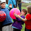 Kasey Quenichet, center, and her brother Kaleb Quenichet play a game resembling hot potato at the YMCA's Healthy Kids Day and Purdue Extension's Spring Festival on Saturday. The event was held at Purdue Research Park in New Albany. Staff photo by C.E. Branham
