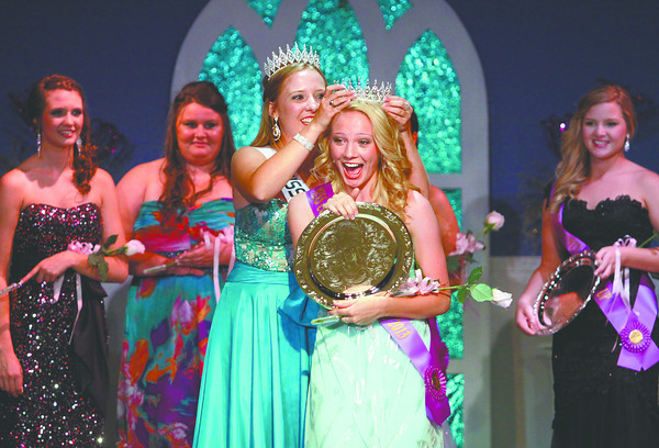 Courtney Morgan was crowned the 2013 Miss Clark County 4-H Fair Queen by 2012 Queen Candace Popp Tuesday night at the Clarksville Little Theatre. As Miss Clark County Morgan will reign over the Clark County 4-H Fair, which begins on July 12, and go on to compete in the Miss Indiana Pageant. Staff photo by C.E. Branham