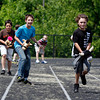Miles Spite and Tristin Thieneman, fifth-graders at Highland Hills Middle School, race in the school's inagural Fifth Grade Derby on Wednesday. Students studied about the track and the history of the Kentucky Derby in their classes. Staff photo by Jerod Clapp