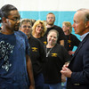 Gov. Mitch Daniels talks with Advanced Metal Technologies of Indiana employee Ray Moss after a press conference announcing AMT's plans to invest $19 million in its Jeffersonville operation and create an additional 350 jobs by 2015. Staff photo by C.E. Branham