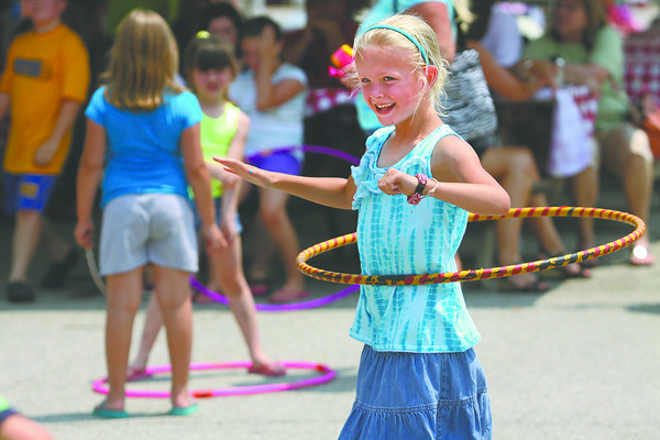 Anna Knecht spins her way to winning the hula hoop contest for her age group at the Charlestown Founder's Day celebration Saturday afternoon. Staff photo by C.E. Branham