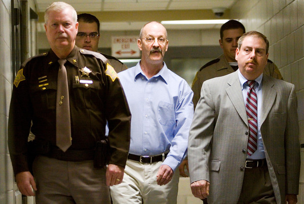 William Clyde Gibson III is escorted to Floyd County Superior Court No. 1 for the closing remarks of his sentencing hearing in the City-County Building in New Albany on Tuesday morning. Gibson was convicted in the murder of Christine Whitis by a jury last Friday afternoon. Staff photo by Christopher Fryer
