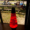 A lava lamp sits in a window as attendants catch up outside during the first Kids That Grew Up In The 60's and 70's In Clark County reunion at Lapping Park in Clarksville on Saturday afternoon. Staff photo by Christopher Fryer